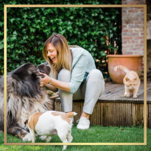 Cathy with dogs and cat